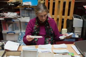 volunteer sorting cheques